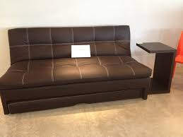 new futon sofa with pull out bed underneath and side table for