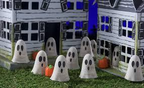 diy spooky village with concrete ghosts diycandy com