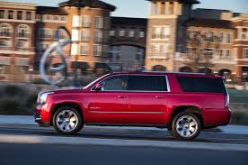 chevrolet suburban red 2015 chevrolet tahoe suburban and gmc yukon xl and denali first