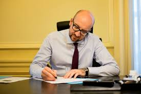 michel bureau prime minister invites companies to move to belgium