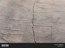 fractured surfaces of stamped concrete pavement outdoor