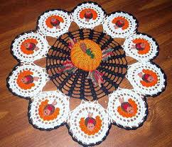 thread crochet doily complete with central pumpkin and a ring of