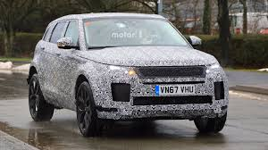 camo range rover heavily disguised 2019 range rover evoque spotted