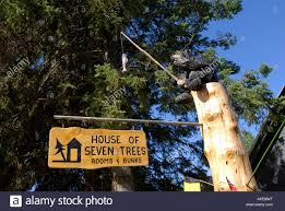 sign for house of seven trees rooms and bunks in town of talkeetna