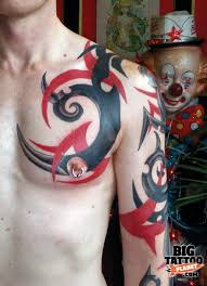 black and red ink tribal tattoo on chest tattooshunt com