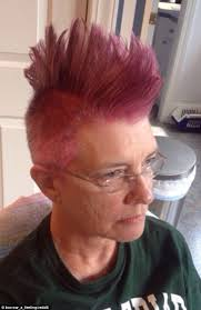 best hairstyles for a 48 year old mother with breast cancer shaves her hair into a bright pink