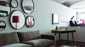 que mettre au dessus d un canapé où placer un miroir dans mon salon