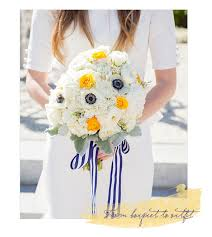 navy and white striped ribbon from bouquet to navy stripes pops of yellow white