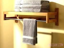 bathroom wall cabinet with towel bar bathroom wall towel holder hanging towel rack in bathroom image of