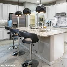 black leather stools and bold geometric light fixtures add allure