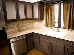 brown wooden kitchen cabinet and cream backsplash also cream