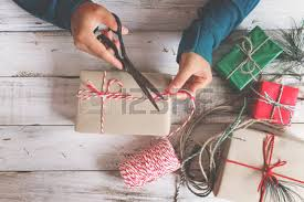 merry christmas and happy new year flat lay hands wrapping red