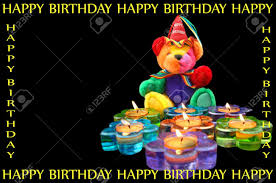 happy birthday teddy bear sits in front of flower shaped candles