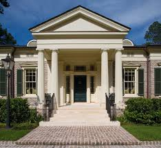 brick paver patterns for a traditional exterior with a bushes and