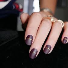 nail design center band of gold elevate a burgundy matte manicure with an