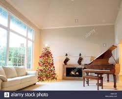 Small Living Room With Fireplace And Piano Christmas Tree In Living Room With Burning Fireplace And Grand