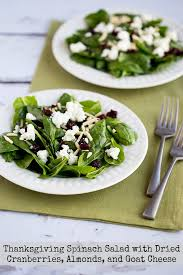 thanksgiving spinach salad with dried cranberries almonds and