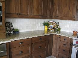Kitchen Backsplash Dark Cabinets by Dark Stained Knotty Alder With Granite Venecian Gold Granite