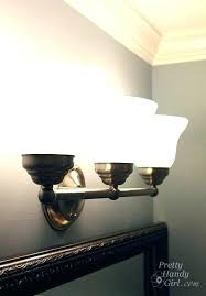 How To Change A Bathroom Light Fixture How To Remove Bathroom Light Fixture Cover Simpletask Club