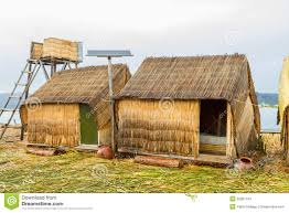 hand made houses in uros peru south america stock photos