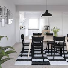 dining rooms striped area rug black hanging lamp scandinavian
