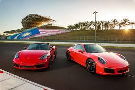 porsche boxster vs 911 feature porsche 718 boxster s 911 4s driven on track