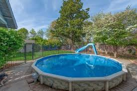 Backyard Pool With Slide 14 Great Above Ground Swimming Pool Ideas