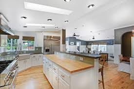 white ceiling trailer homes with white cabinet on the wooden floor