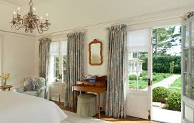 attractive french bedroom with country accent floral blue curtains