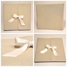 ivory satin ribbon photo album covered in linen and white satin ribbon