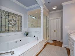 traditional master bathroom with crown molding u0026 stone tile in