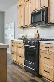 light wood kitchen cabinets with black hardware hgtv presents contemporary kitchen with black gas range and