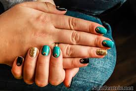 how to create blue black and gold nail art with metal studs