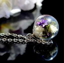 real bouquet in a glass bead moss terrarium necklace dried