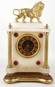 Metal Mantel Clock A 19th Century French Alabaster And Gilt Metal Mantel Clock The