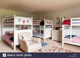 White Wooden Bunk Bed White Wooden Bunkbeds In Childrens Bedroom With Armchair And Stock