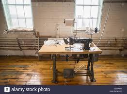 Singer Sewing Machine Desk An Antique Black Singer Sewing Machine Attached To An Antique
