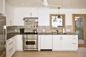 contemporary custom kitchen with quartz counters limestone
