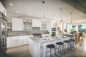 interior design for new construction homes the cool grey and white in this kitchen makes a dash of color