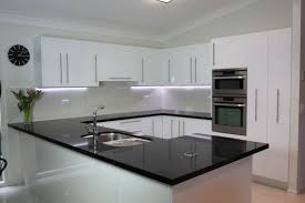 white kitchen cupboards black bench black benchtop white cupboards classic style that never