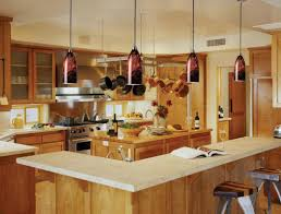 cherry wood cordovan madison door lighting over kitchen island