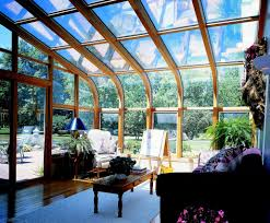 curved glass roof sunroom or solarium with wood interior