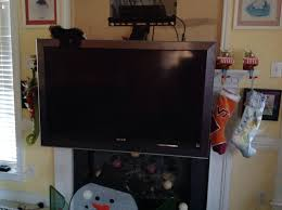 Mounting A Tv Over A Gas Fireplace by Drywall How Do I Mount A Tv To Cover A Cubby Hole Above My