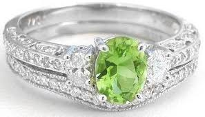 peridot engagement rings vintage inspired peridot and oval diamond engagement ring and