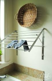 wall mounted drying rack in laundry room farmhouse with clothes