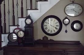 home decor wall clocks like the idea of different sized clocks on the side of the