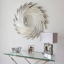 this elegant round silver swirl wall mirror is made of wood with