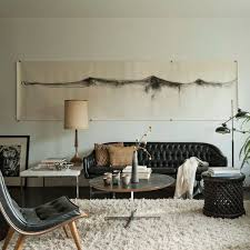 Neutral Sofa Decorating Ideas by How To Decorate A Living Room With A Black Leather Sofa Decoholic