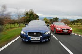 compare lexus vs bmw bmw 335i m sport vs jaguar xe s head 2 head comparison motor trend