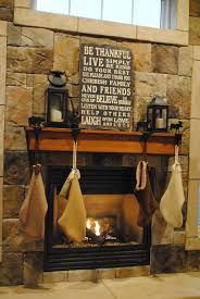 decorations rustic christmas fireplace alongside stone wall